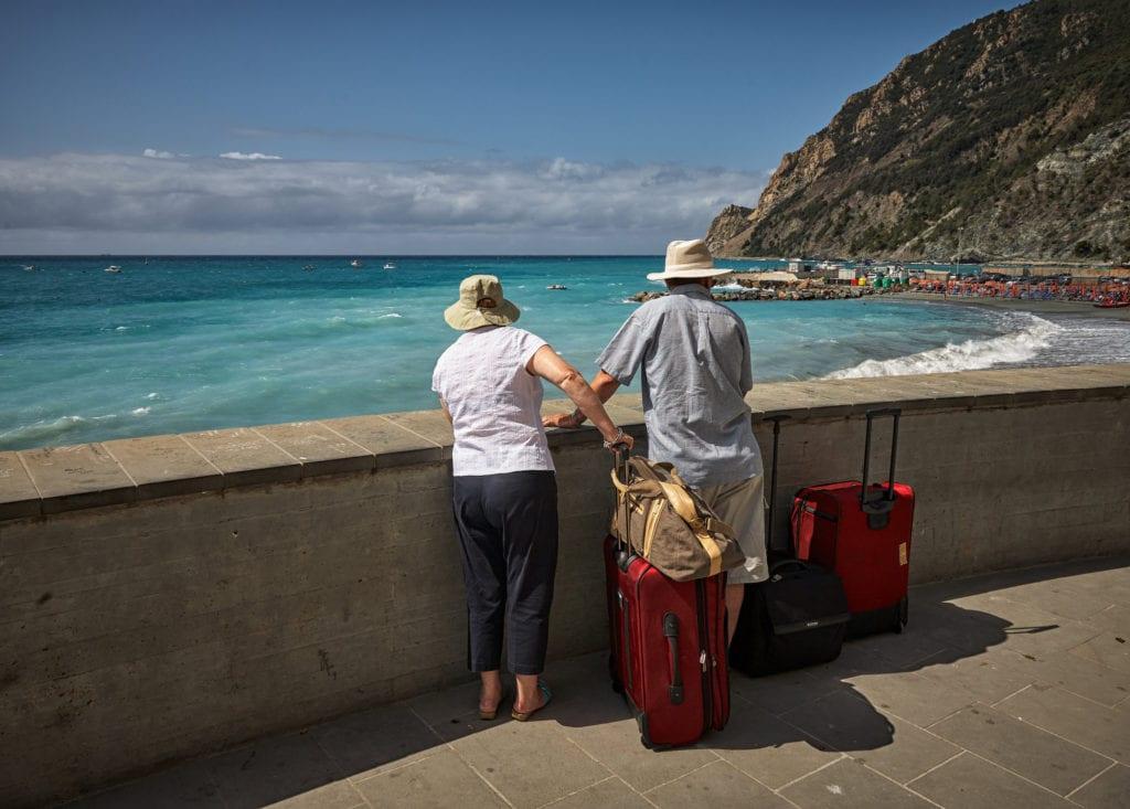 elderly couple enjoying the beach