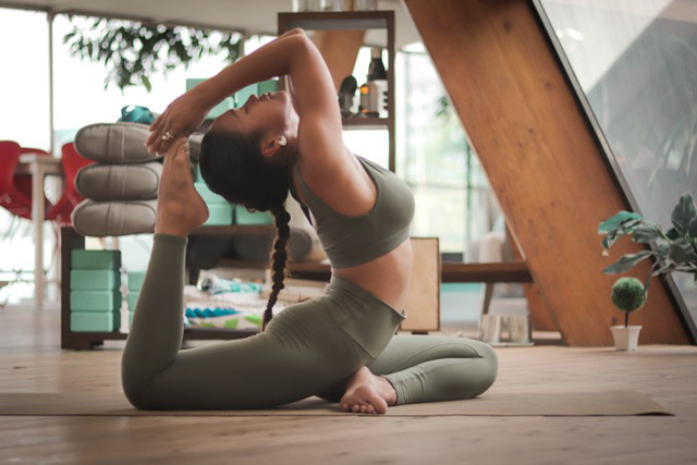 Woman doing yoga pose on floor